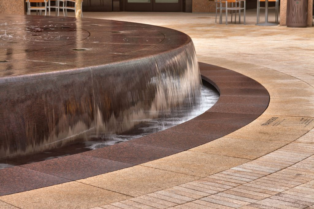 Pepper Brown granite was used as paving throughout the project. Photo Credit: Martin van Hemert