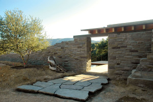 When constructing the home, installers pieced together a little more than two dozen pieces of large-format Bluestone flagstone paving at the entry of the home to create a one-of-a-kind walkway. Photo courtesy of Bohlin Cywinski Jackson.