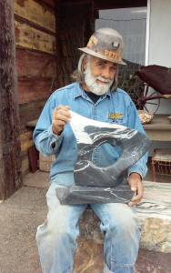 Pete shows off one of his free-form sculptures, carved from a scrap of the black marble from his stockpile. As with the Mayer quarry onyx, even small (unflawed) pieces can be valuable.