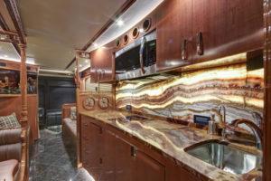 Onice Fantastico onyx countertop and backsplash. Tan Brown granite flooring. Photo courtesy of Florida Coach in Kissimmee, Florida.