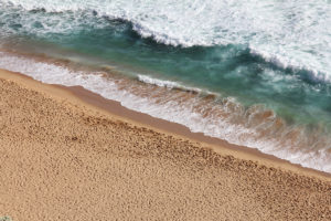 Beach sand may have once been granite, and now it's on its way to becoming sandstone.