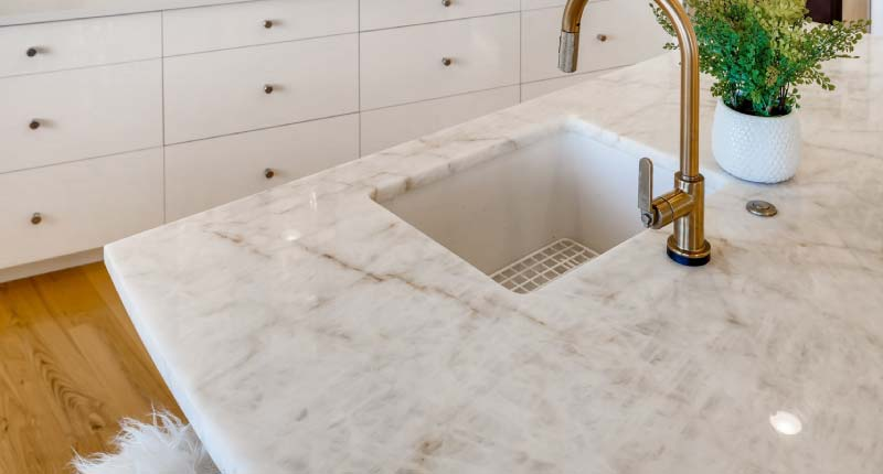 How to Make Natural Stone Play a Starring Role in a Kitchen Design